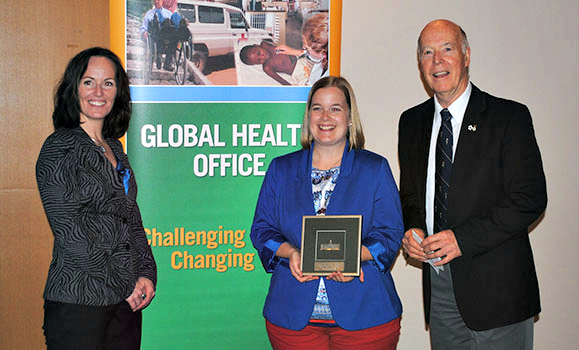 Danielle (centre) receives her award from Shawna O'Hearn (Director of the Global Health Office) and Dr. Ron Stewart.