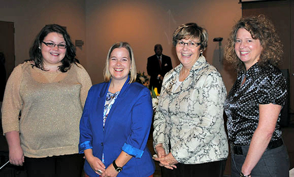 Danielle celebrates her award with Nursing colleagues (from L-R) Katie VanPatter, Dr. Kathleen MacMillan (Director) and Dr. Megan Aston.